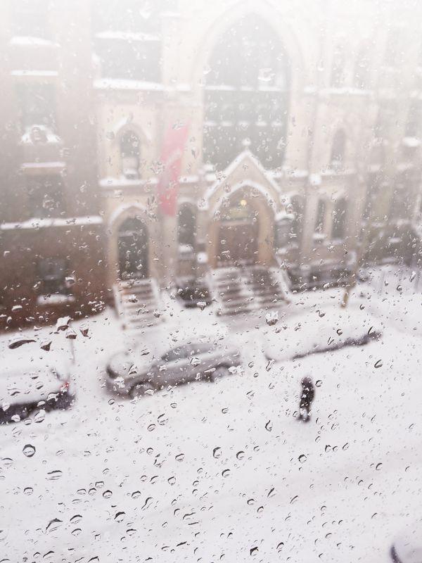 Photo of Snowy City Through Rainy Window