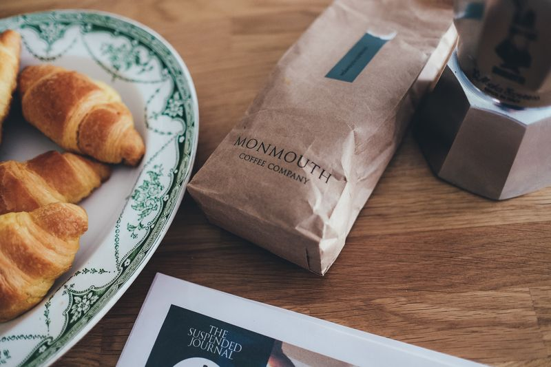 Photo of Coffee Grounds and Croissants