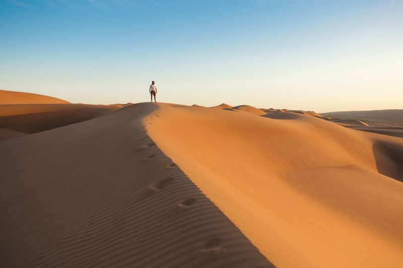 Photo of Man on Sand Dunes
