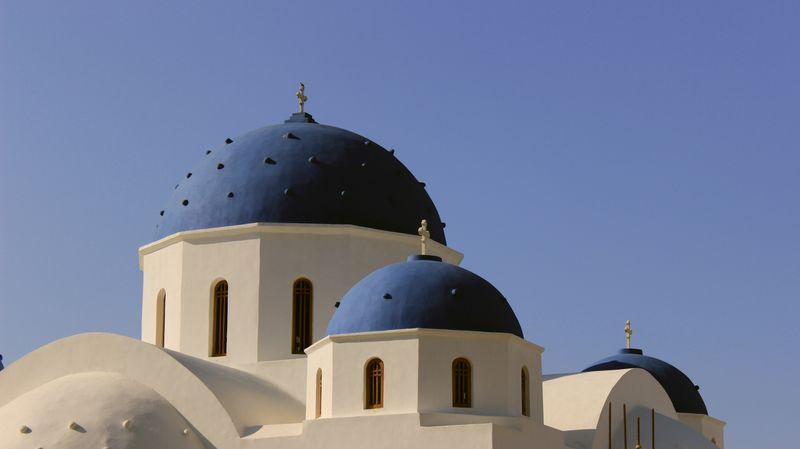 Photo of Blue-Domed Church in Santorini, Greece