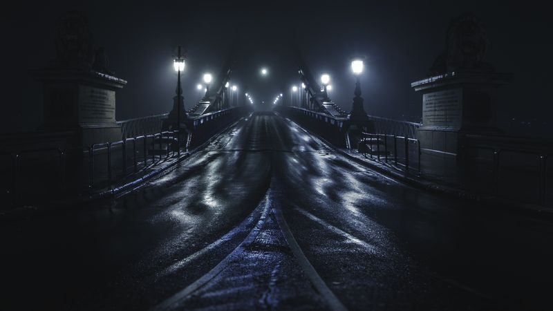Photo of Bridge on a Dark and Foggy Night