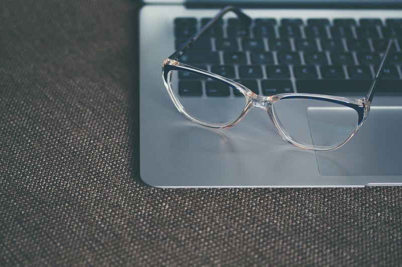 Photo of Eyeglasses on Laptop