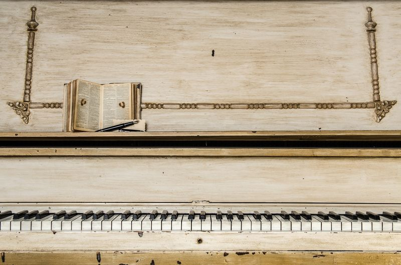 Photo of Bible Sitting on Vintage Piano