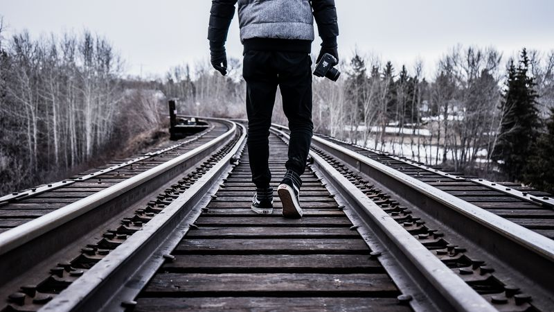 Photo of Person on Train Tracks