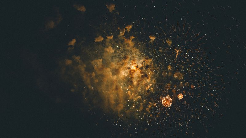 Photo of Fireworks in Cloudy Sky