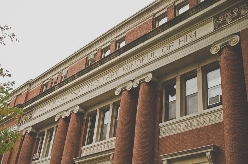 Photo of Scripture on Harvard Building