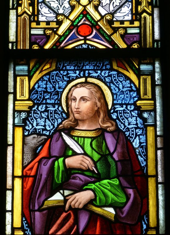 Photo of Man Writing Stained Glass