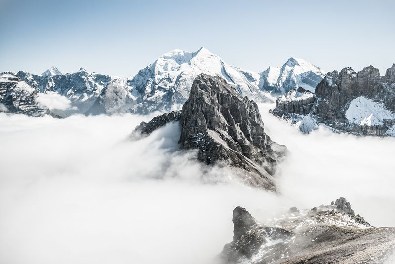 Photo of Foggy and Snowy Mountains