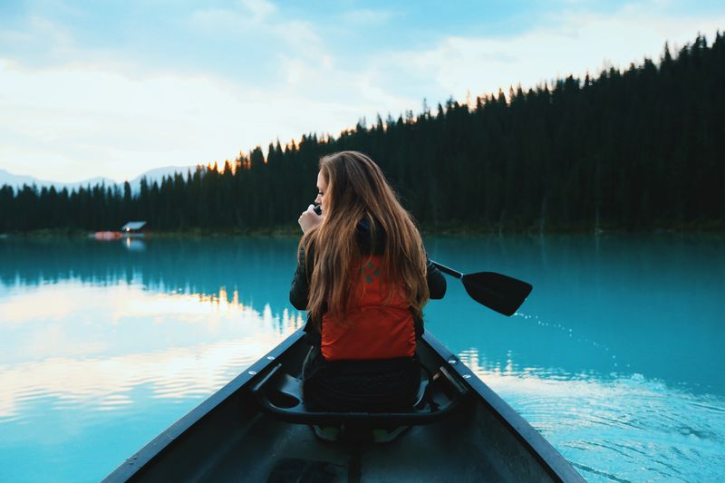 Photo of Woman in Canoe on Lake