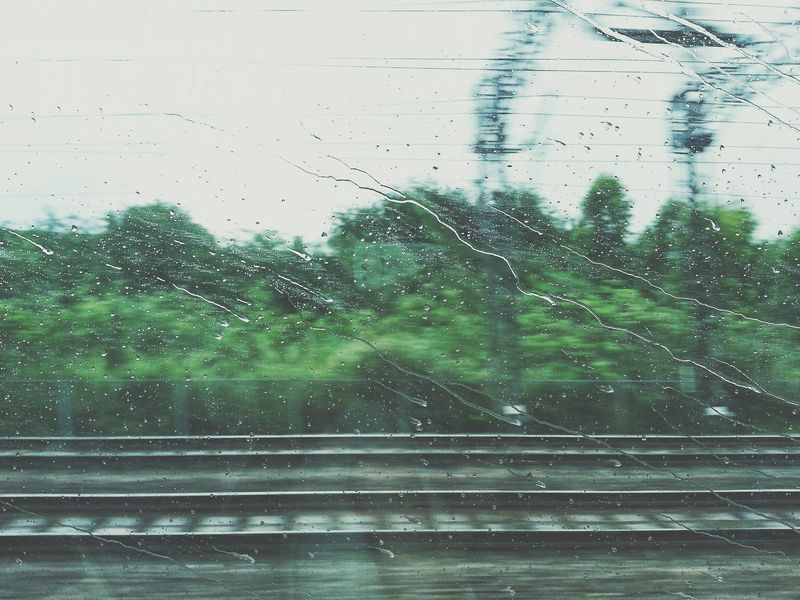 Photo of View from Rainy Traincar Window