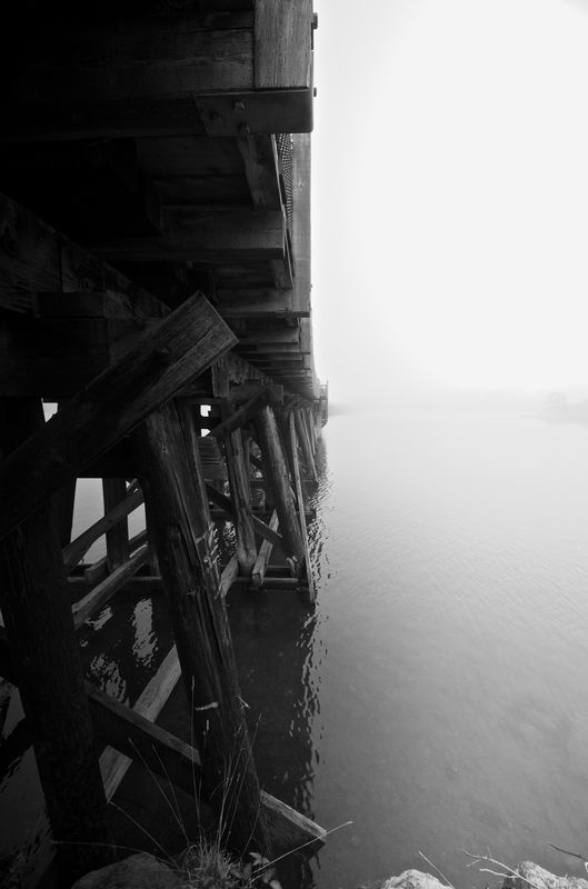 Photo of Underneath Wooden Bridge