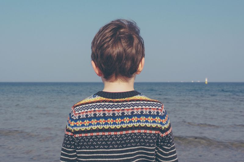 Photo of Child Looking at Ocean
