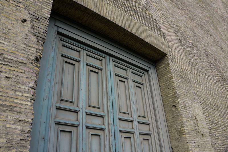 Photo of Wooden Doors on Brick Building