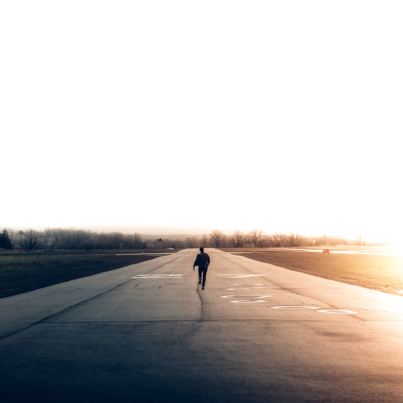 Photo of Man Running on Tarmac