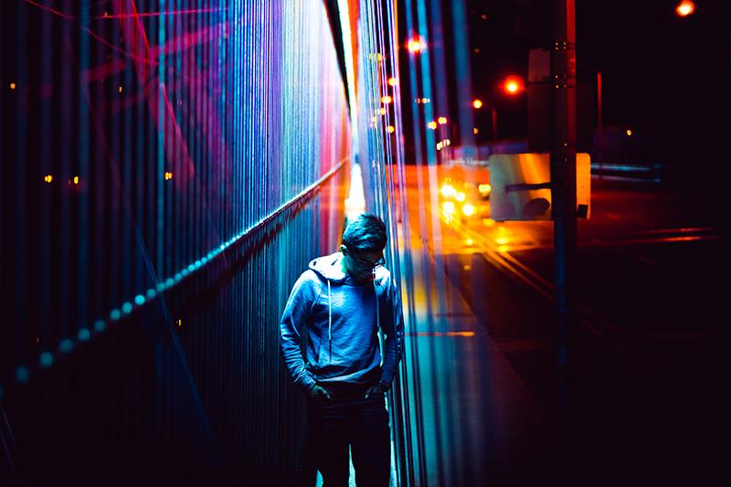 Photo of Man on Bridge