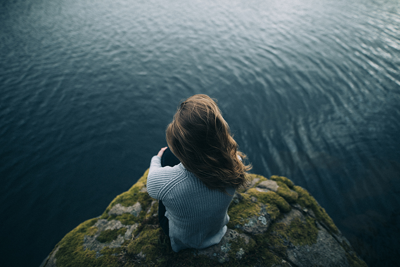 Photo of Woman Looking at Ocean