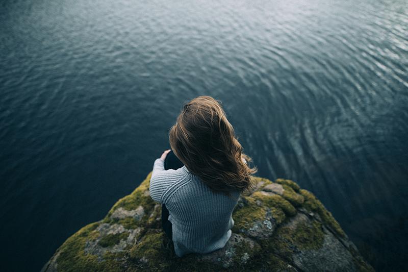 Photo of Woman Looking at Ocean