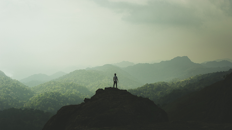 Photo of Man on Hilltop