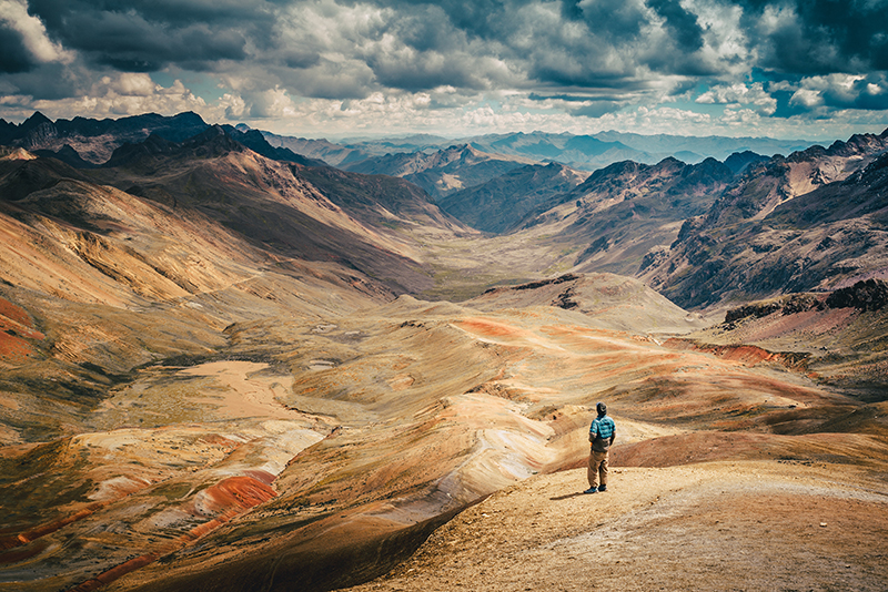 Photo of Man with Mountains