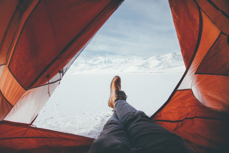 Photo of Person in Tent in Snow