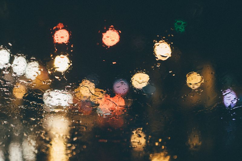 Photo of Blurry Lights Through Rainy Glass