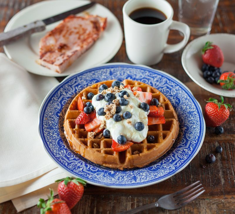 Photo of Breakfast Spread with Waffles and Fruit