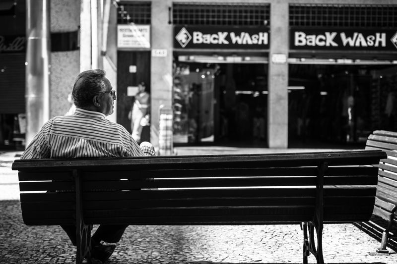 Photo of Man Sitting on Bench