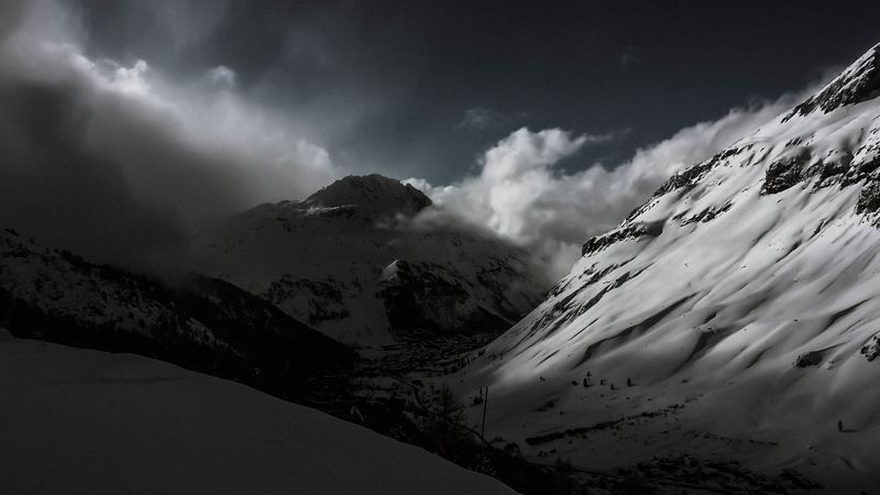 Photo of Snowy Mountains and Clouds