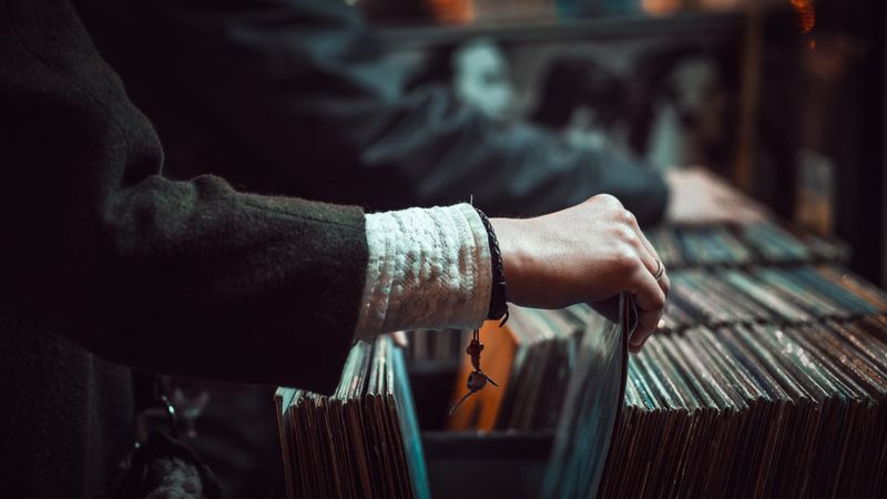 Photo of Person Looking at Vinyl Records