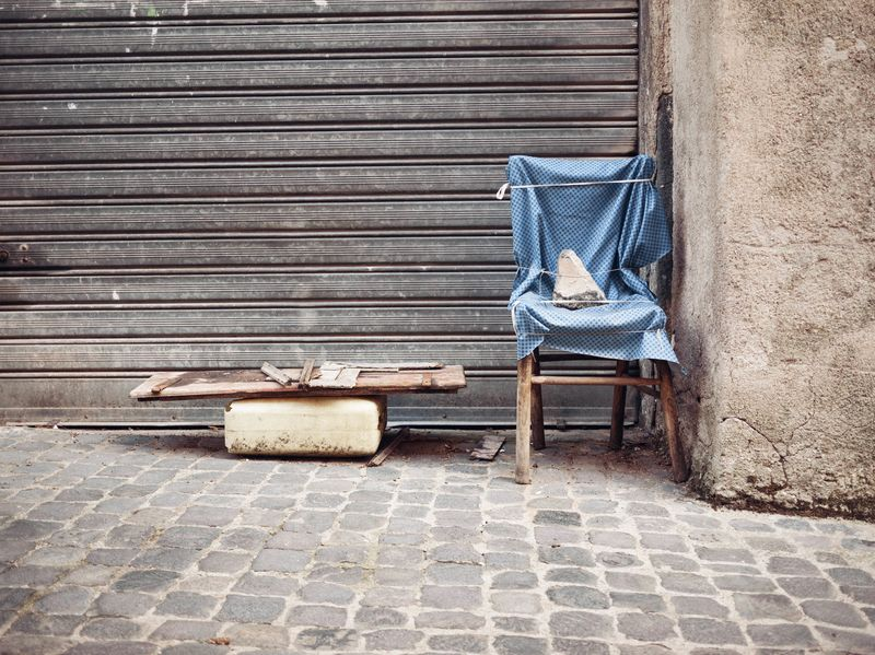 Photo of Chair and Junk on Roadside