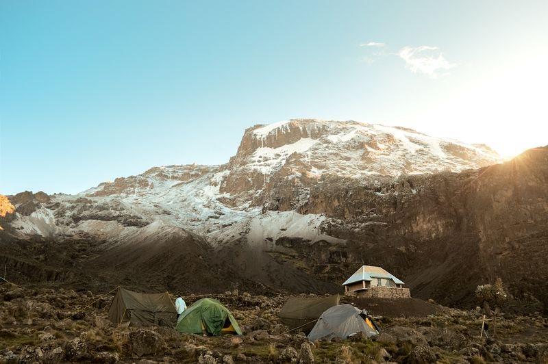 Photo of Tents in Mountain Foothills