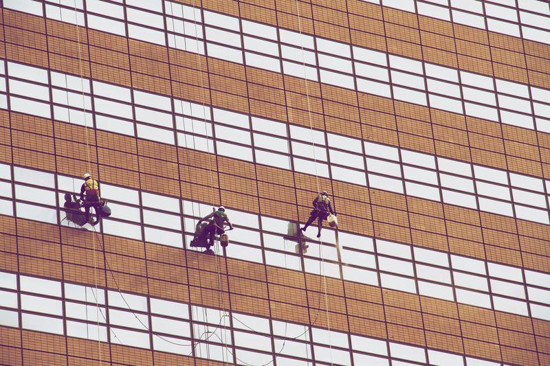 Photo of Men Washing Windows