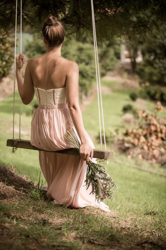 Photo of Woman Sitting on Swing