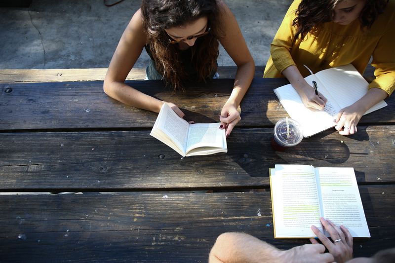 Photo of Three People Reading