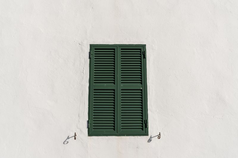 Photo of Green Window Shutters on White Wall