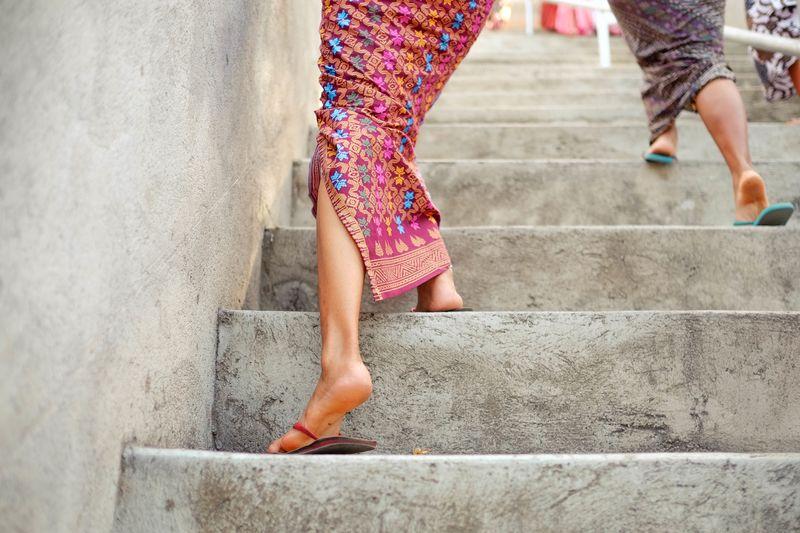 Photo of Women Walking Up Steps