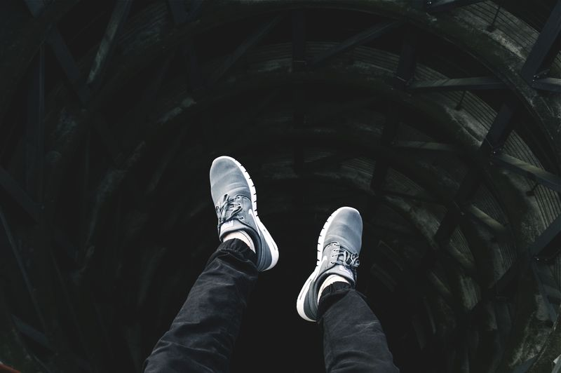 Photo of Legs Hanging Off Ledge