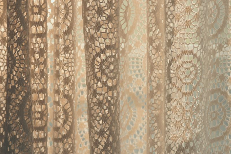 Photo of Sun Shining Through Lace Curtains