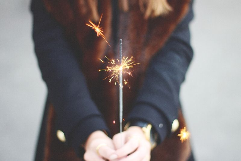 Photo of Sparkler in Woman's Hands