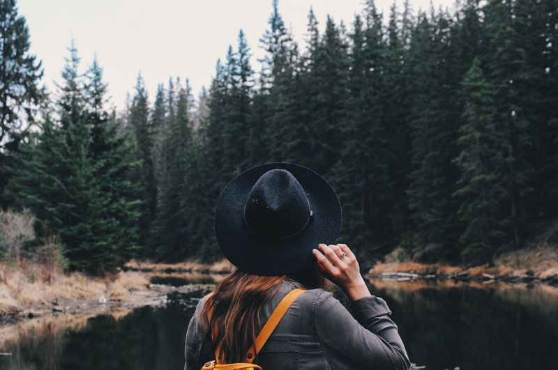 Photo of Woman Looking at River and Forest